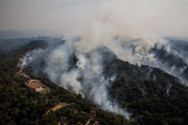 23 dead, hundreds missing as California wildfires spread -NY Daily News