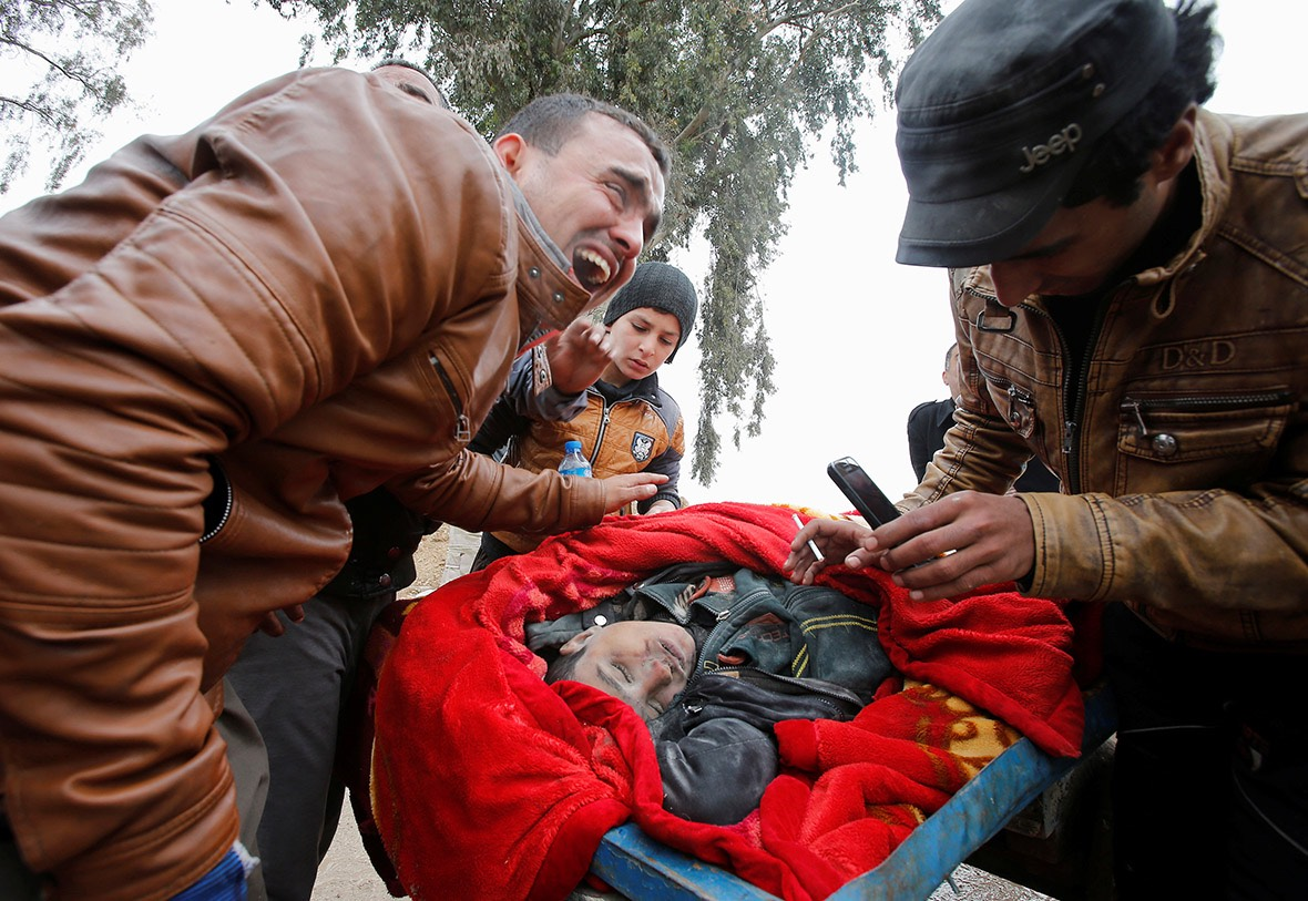 A father mourns his son who was killed in air strike on MosulYoussef Boudlal:Reuters