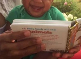 Baby Boy Laughs Hysterically at Book of Animals -onenewspage.com