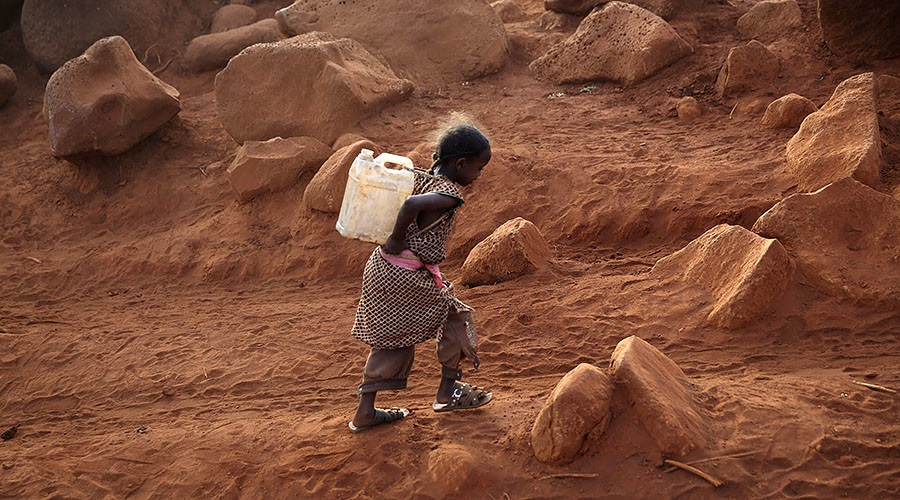 child-fetching-water-Goran Tomasevic : Reuters