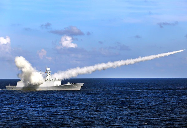 Chinese missile frigate launching an air-defense missile near Hainan and Paracel islands. AP