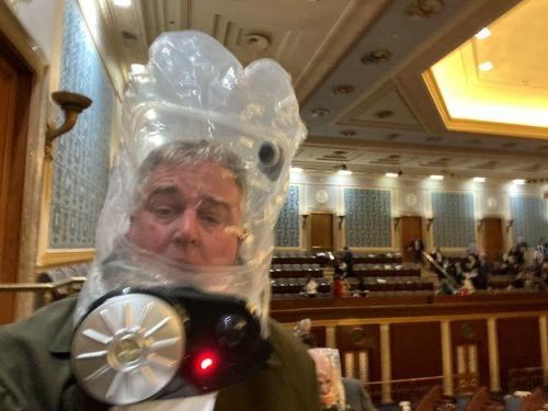 Congressman David Trone evacuating the Capitol with Kodos & Kang-style headgear.