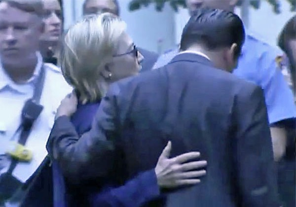 Hillary Clinton receives help walking away during a ceremony on Sept ... Hillary Clinton receives help walking away during a ceremony