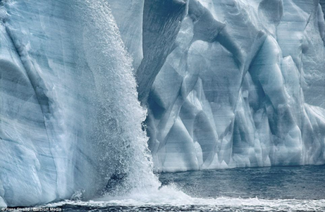ice melting into the ocean -Hans Slrand Barcroft Media