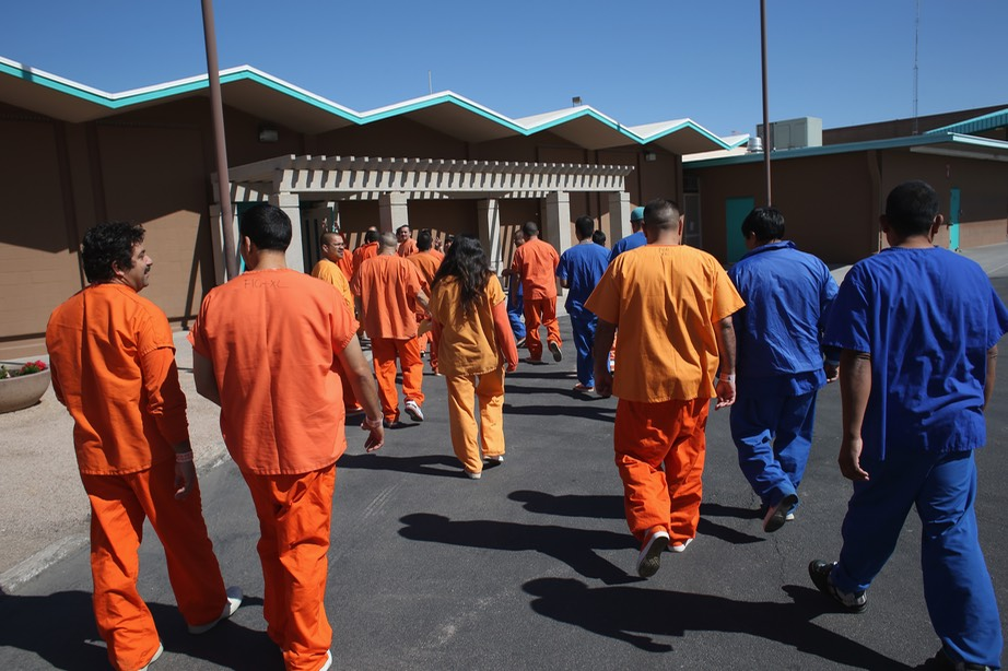 Immigrant detainees walk through the ICE detention facility in Florence, Ariz., on Feb. 28, 2013. Photo- John Moore:Getty Images