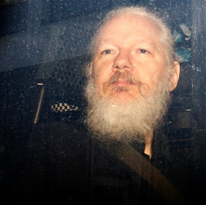 Julian Assange en route to court following his arrest by British police -Henry Nicholls:Reuters