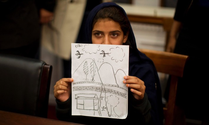 Nabila Rehman, 9, holds up a picture she drew depicting the US drone strike on her Pakistan village which killed her grandmother. Photograph- Jason Reed:Reuters