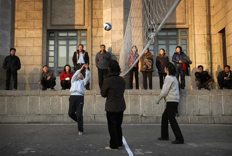 North Korean women play volleyball on Kim Il Sung Square at the end of work day in Pyongyang, North Korea -Wong Maye-E AP