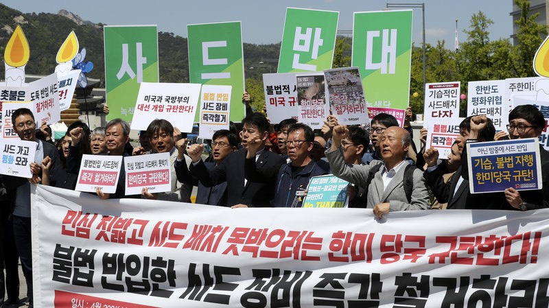Protesters shouted slogans Wednesday, as an advanced U.S. missile defense system, the Terminal High-Altitude Area Defense, or THAAD, was being installed in South Korea. Lee Jin-man:AP