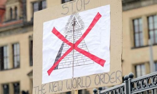 protester's sign saying 'Stop The New World Order' near the venue of the 2016 Bilderberg conference in Dresden, Germany. Photograph- Chad Buchanan:Getty Images