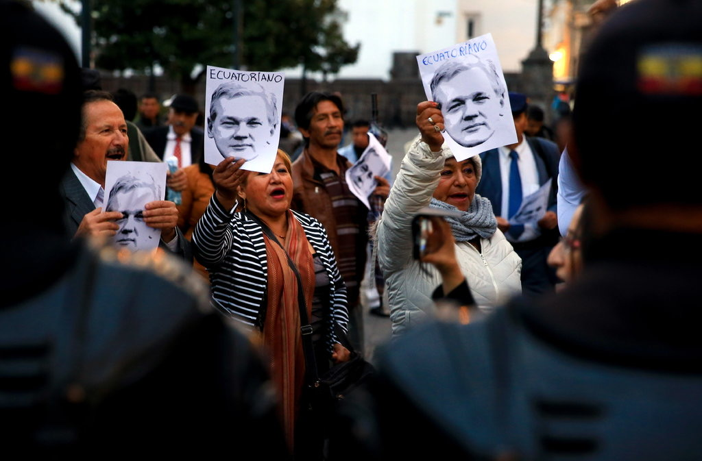 rally in Quito, Ecuador, in support of the WikiLeaks founder Julian Assange, who has been holed up in the country's embassy in London since 2012.CreditCreditJose Jacome:EPA, via Shutterstock