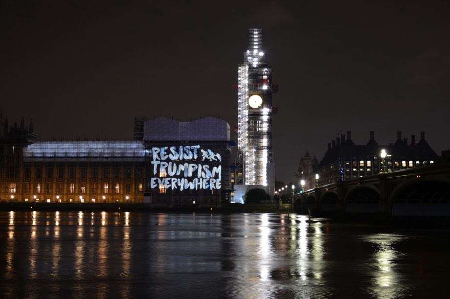 "SumOfUs projecting the message ""resist Trumpism everywhere"" onto the Palace of Westminster, London's iconic Marble Arch"