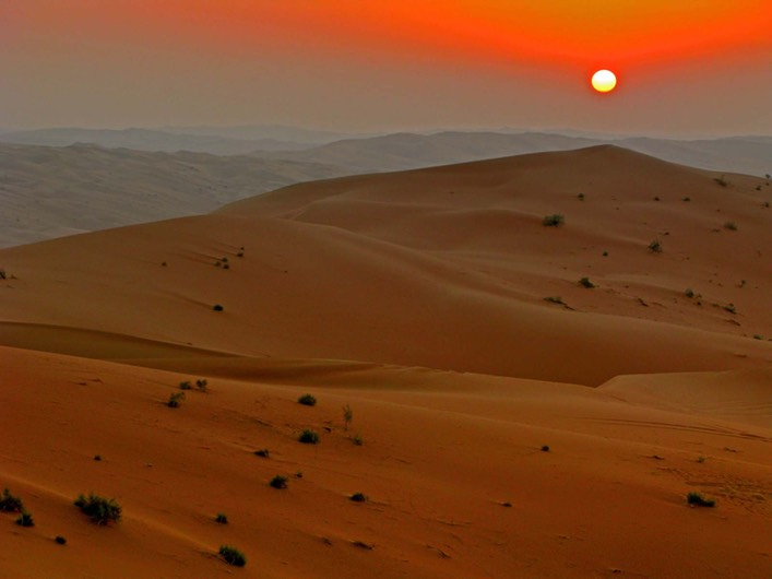 "Sun setting over the Rubʿ al-Khali (""Empty Quarter""), the largest portion of the Arabian Desert in the southern Arabian Peninsula. Javierblas"