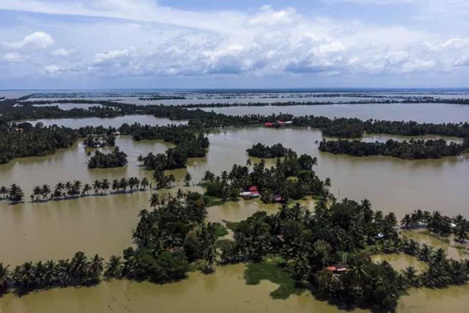 Trees and houses are partially submerged in floodwaters in this aerial photograph taken in Kainakary village in the district of Alappuzha, Kerala. -Bloomberg