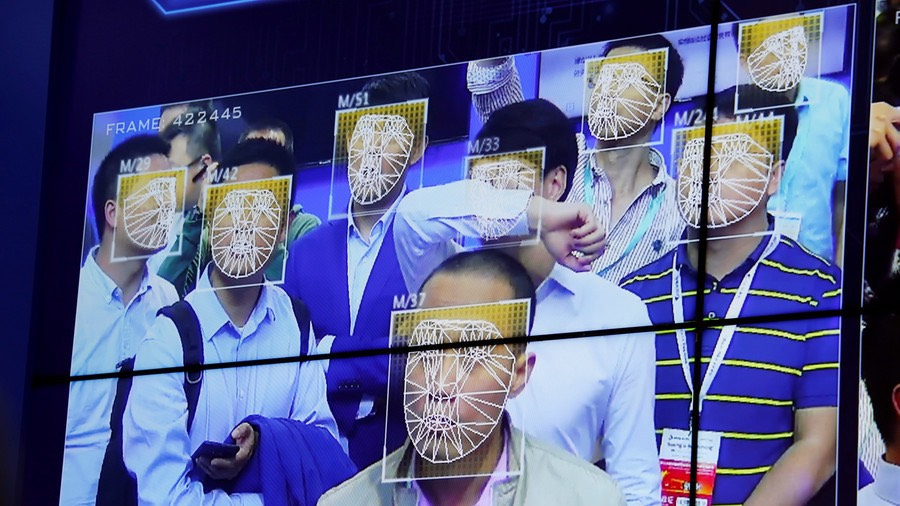 Visitors experience facial recognition technology at Face++ booth during the China Public Security Expo © Bobby Yip : Reuters