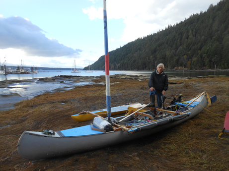 William-Thomas-with-my-solar-electric-outrigged-sailing-canoe-Electra -King Anderson photo