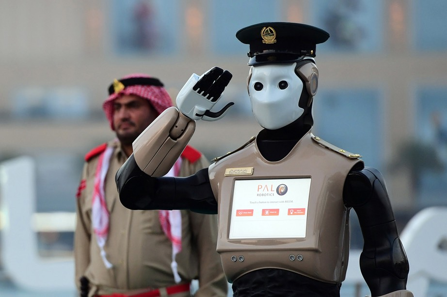world's first operational police robot stands at attention during preparations for a military cannon to fire to mark sunset and the end of the fasting day for Muslims observing Ramadan, in Downtown Dubai on May 31, 2017